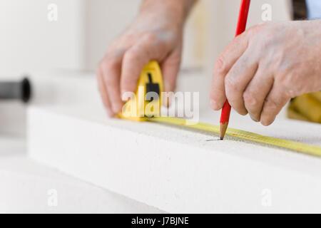 measured sured measure professional improvement handyman supplier contractor - Stock Photo
