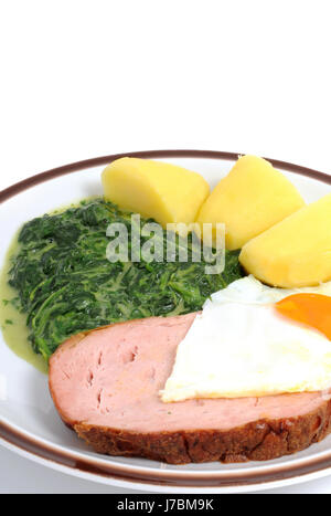 leberkaese with spinach - Stock Photo