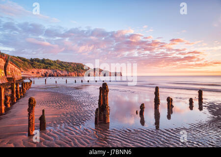 A beautiful sunrise at Sandsend Beach, Whitby, North Yorkshire, England, UK - Stock Photo