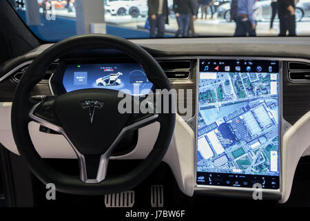 BRUSSELS - JAN 19, 2017: Interior dashboard with navigation of the Tesla Model X car on display at the Motor Show - Stock Photo
