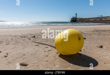 Yellow buoy 'bathing zone' on the beach of Les Sables d'Olonne at low tide - Stock Photo
