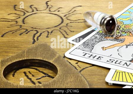 the sun shown by fortune telling accessories - Stock Photo
