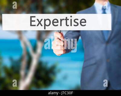 Expertise - Businessman hand holding sign. Business, technology, internet concept. Stock Photo - Stock Photo