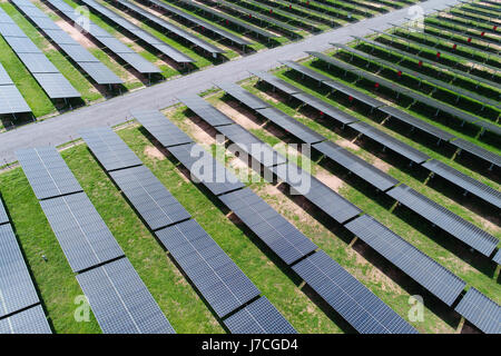 solar power station in the field by drone. Aerial view of Solar cell farm. Solar farm, solar panels from the air - Stock Photo
