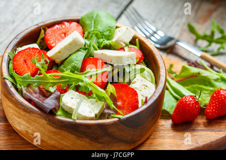 Vegan salad with tofu and strawberries. Love for a healthy vegan food concept - Stock Photo