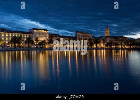 Waterfront of town Split in dawn; Dalmatia, Croatia - Stock Photo
