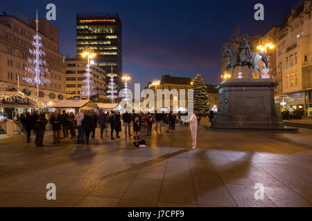 Sunset above central square in the city of Zagreb during the Advent, Croatia - Stock Photo