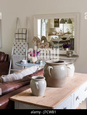 Large ceramic urns on wooden console table from Haus in open plan kitchen / sitting room
