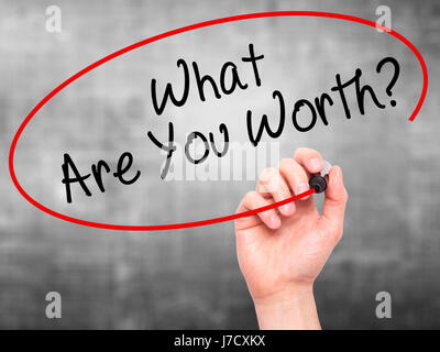 Man Hand writing What Are You Worth? with black marker on visual screen. Isolated on grey. Business, technology, - Stock Photo