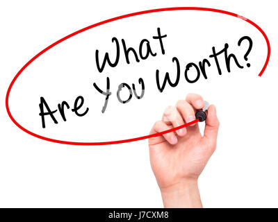 Man Hand writing What Are You Worth? with black marker on visual screen. Isolated on white. Business, technology, - Stock Photo