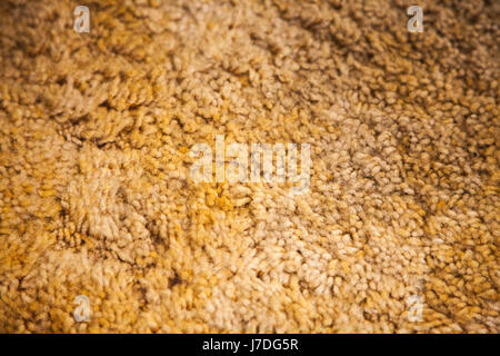 Soft yellow carpets closeup background. - Stock Photo