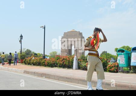 A Policeman Walks Through The Road Of India Gate After Rehearsal. - Stock Photo