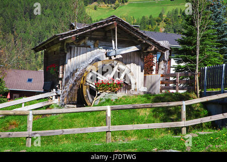 Wooden wheel of an ancient water mill in Dolomiti - Stock Photo