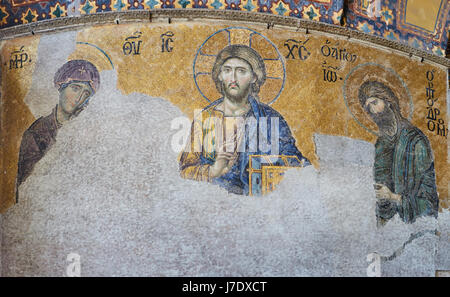 13th century Deesis Mosaic of Jesus Christ flanked by the Virgin Mary and John the Baptist in the Hagia Sophia temple - Stock Photo