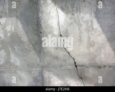 Stove reinforced concrete fence. Gray concrete wall. Background texture - Stock Photo