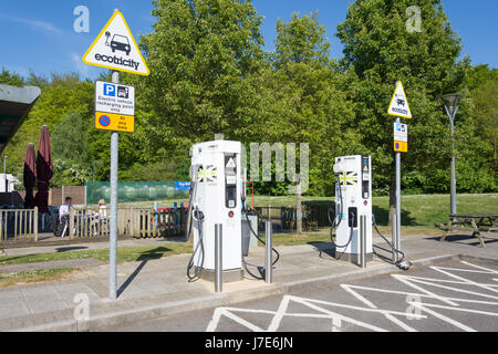Ecotricity auto electric charger terminals, Winchester M3 Motorway Services, Winchester, Hampshire, England, United - Stock Photo