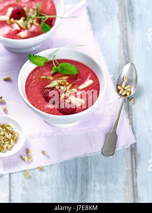 Tomato raspberry smoothie bowl - Stock Photo