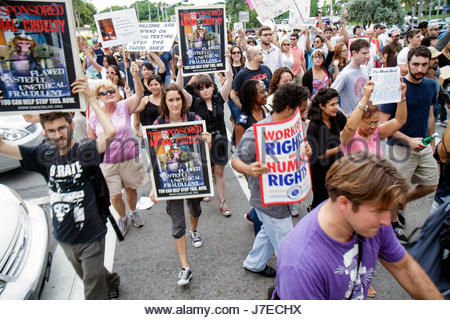 Miami Florida Biscayne Boulevard Freedom Torch Occupy Miami demonstration protest protesters anti Wall Street banks - Stock Photo