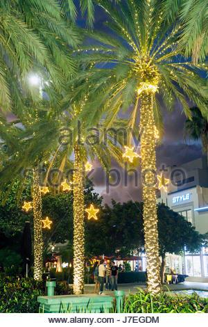 Miami Beach Florida Lincoln Road pedestrian mall palm trees landscaping Christmas decor decorations lighting stars - Stock Photo