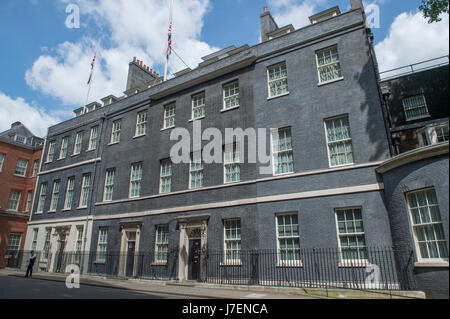 Downing Street, London, UK. 24th May 2017. Union flags fly at half-mast over 10 & 11 Downing Street after the Manchester - Stock Photo
