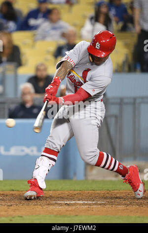 Los Angeles, CA, USA. 24th May, 2017. St. Louis Cardinals second baseman Kolten Wong #16 makes contact at the plate - Stock Photo