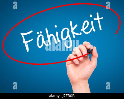 Man Hand writing Fahigkeit (Ability in German) with black marker on visual screen. Isolated on background. Business, - Stock Photo