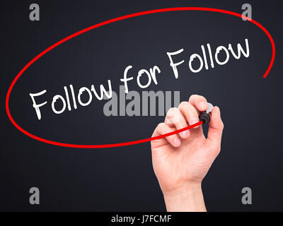 Man Hand writing Follow for Follow with black marker on visual screen. Isolated on black. Business, technology, - Stock Photo
