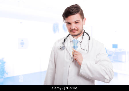 Handsome doctor putting money in his lab coat after payment from a patient - Stock Photo