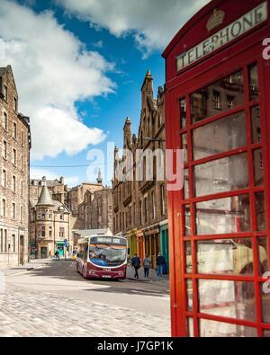 A bus on old street  Candlemaker Row, Edinburgh Scotland - Stock Photo