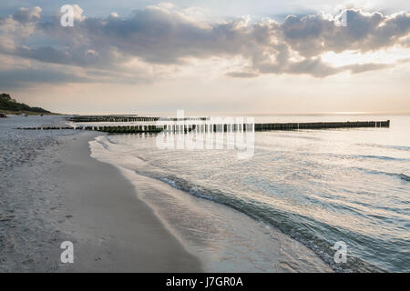 Beach and sea with groynes at Ahrenshoop, Mecklenburg-Vorpommern, Germany - Stock Photo