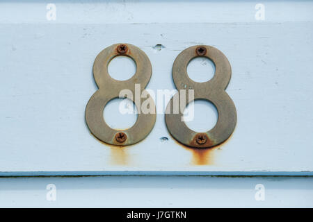 The number 88 on a beach hut - Stock Photo