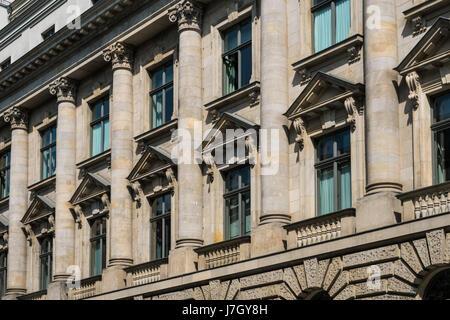 Windows on historic building facade with columns - Stock Photo