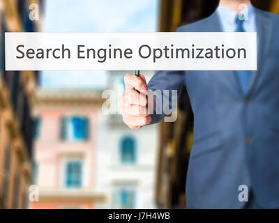 Search Engine Optimization - Business man showing sign. Business, technology, internet concept. Stock Photo - Stock Photo