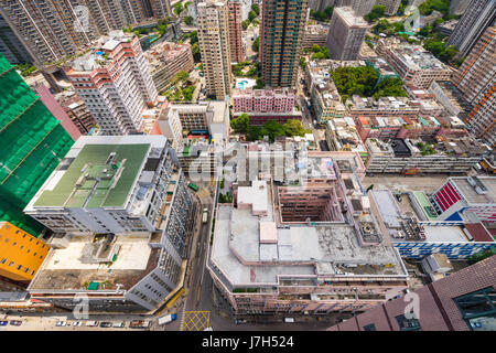 Looking down on to buildings in Hong Kong from a highrise. Hong Kong is a densely populate city with a high percentage - Stock Photo