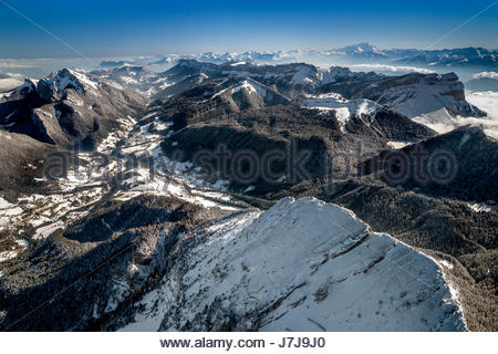 Aerial view over Saint Pierre and Saint Hugues de Chartreuse from above Chamechaude peak in the Chartreuse mountain - Stock Photo