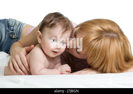 Cute mother kissing her little baby - Stock Photo