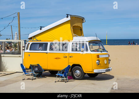 Scheveningen beach, the Netherlands - May 21, 2017: yellow VW combi camper wagen at Aircooled classic car show - Stock Photo