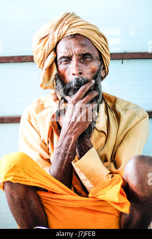 Pathankot, India, september 9, 2010: Indian old holy man sitting on a floor. - Stock Photo