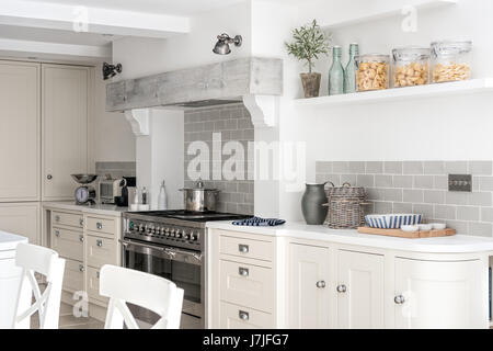Whitewashed beam above range cooker in spacious kitchen. The tiles are Brick Gris Claor from Tile Flair the walls - Stock Photo