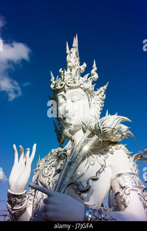 Statues and artwork in the Wat Rong Khun complex, also known as the White Temple. - Stock Photo