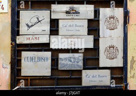 wooden italian wine boxes on restaurant door, sardinia, italy - Stock Photo