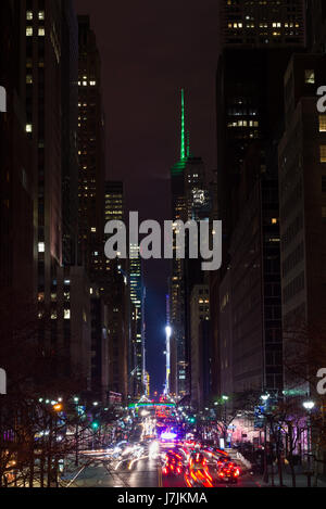 Night Time Long Exposure View Down 42nd Street To Pershing Square And Bank of America Tower With Busy Traffic On - Stock Photo
