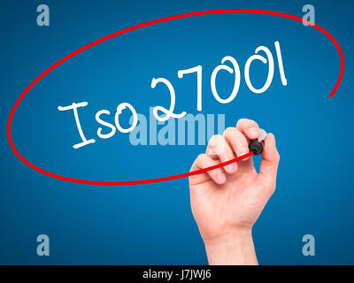 Man Hand writing Iso 27001  with black marker on visual screen. Isolated on blue. Business, technology, internet - Stock Photo