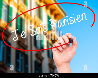 Man Hand writing Je Suis Parisien with black marker on visual screen. Isolated on city. Stock Photo - Stock Photo