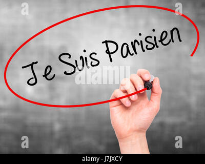 Man Hand writing Je Suis Parisien with black marker on visual screen. Isolated on grey. Stock Photo - Stock Photo