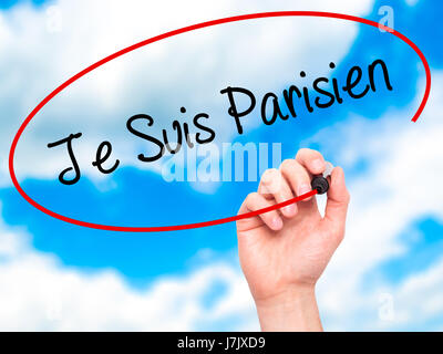 Man Hand writing Je Suis Parisien with black marker on visual screen. Isolated on sky. Stock Photo - Stock Photo