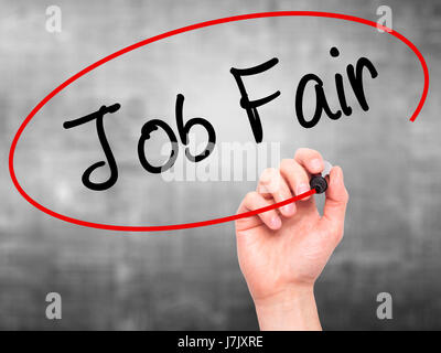 Man Hand writing Job Fair with black marker on visual screen. Isolated on grey. Business, technology, internet concept. - Stock Photo
