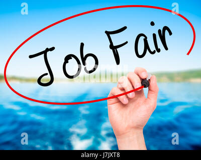 Man Hand writing Job Fair with black marker on visual screen. Isolated on nature. Business, technology, internet - Stock Photo