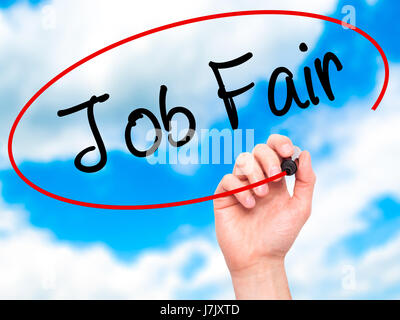Man Hand writing Job Fair with black marker on visual screen. Isolated on sky. Business, technology, internet concept. - Stock Photo