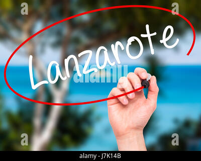 Man Hand writing Lanzarote with black marker on visual screen. Isolated on background. Business, technology, internet - Stock Photo